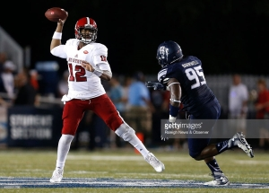 North Carolina State quarterback Jacoby Brissett (12) passes under pressure from Old Dominion defensive end Poncho Barnwell (95) during the second half at S.B. Ballard Stadium in Norfolk, Va., on Saturday Sept. 19, 2015. N.C. State won, 38-14. (Ethan Hyman/Raleigh News & Observer/TNS)