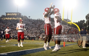 North Carolina State's Maurice Trowell (87) celebrates with Jaylen Samuels (28) after Samuels scored on a 3-yard touchdown run during the first half against Old Dominion at S.B. Ballard Stadium in Norfolk, Va., on Saturday Sept. 19, 2015. N.C. State won, 38-14. (Ethan Hyman/Raleigh News & Observer/TNS)
